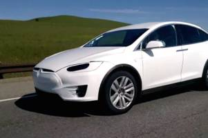 hardly disguised tesla model x caught cruising down the highway like it's no big deal